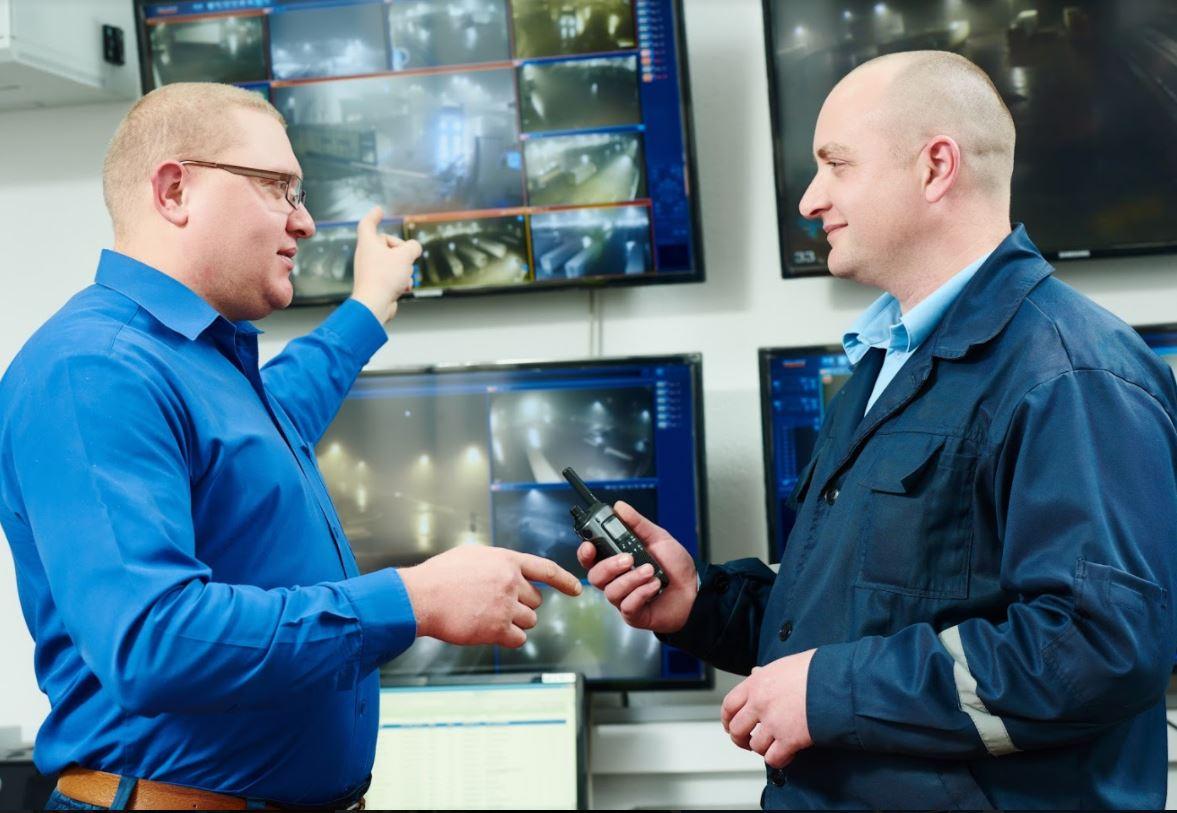 security guards reviewing cameras