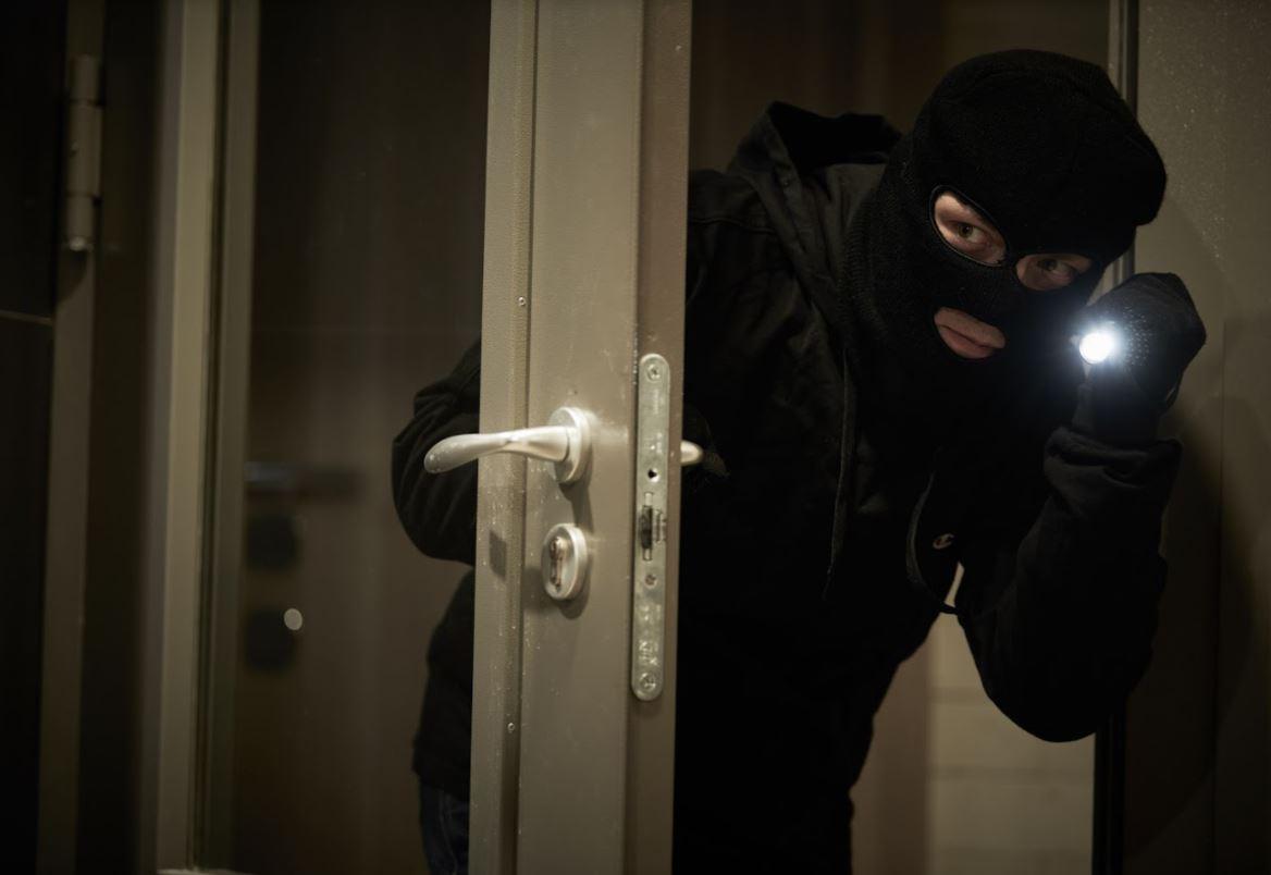 burglar entering home