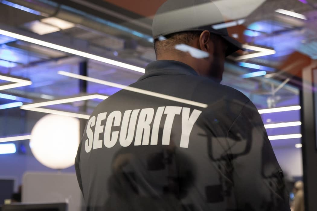 Security guard patrolling at event place inside the building
