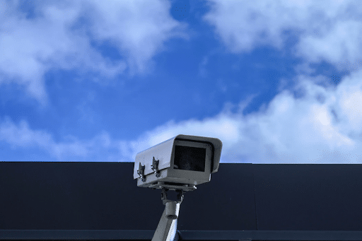 A security camera with the sky in the background