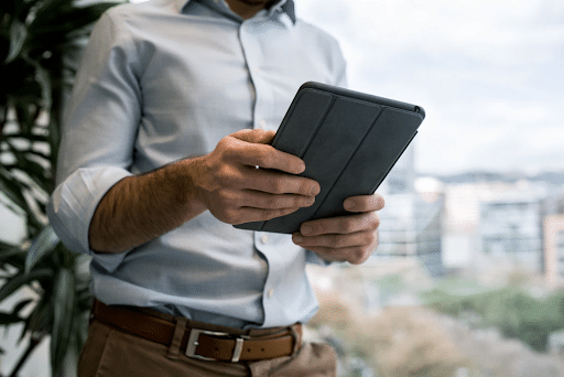 A man holding a tablet