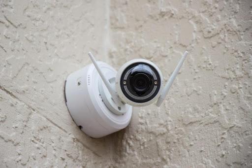 A wireless security camera in the corner
