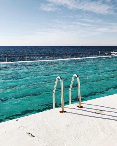 Stairs leading into a pool by the ocean